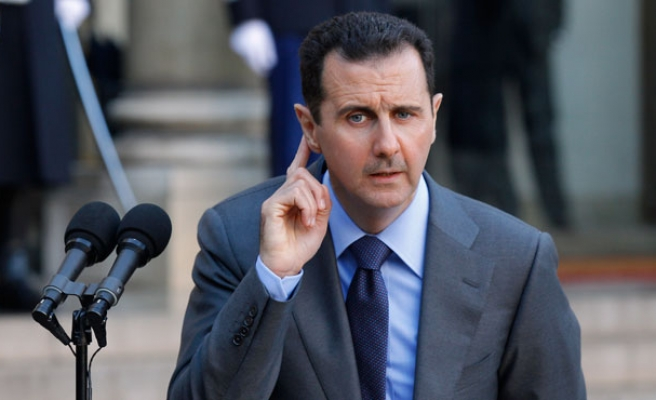 Assad says willing to hold early presidential vote