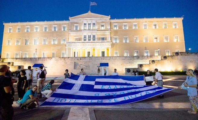Greece approves new austerity measures amid protests