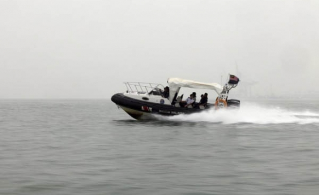 One dead, 14 missing in Malaysia sand dredger capsize