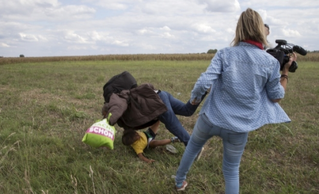 Hungarian journalist fired for assaulting refugees