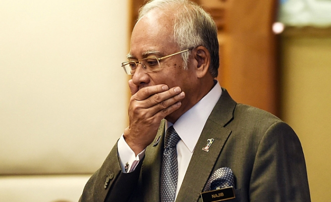 WSJ reports on Malaysia PM's luxury buys, election payouts