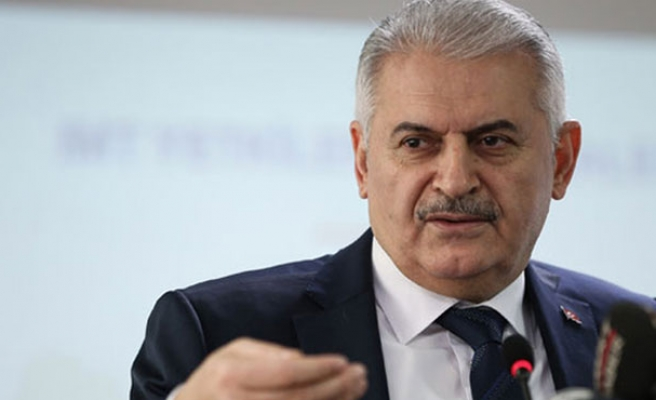 Yildirim says Turkey will respond to any Raqqah threats