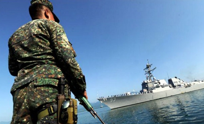 Philippines concerned over Chinese boats near disputed shoal