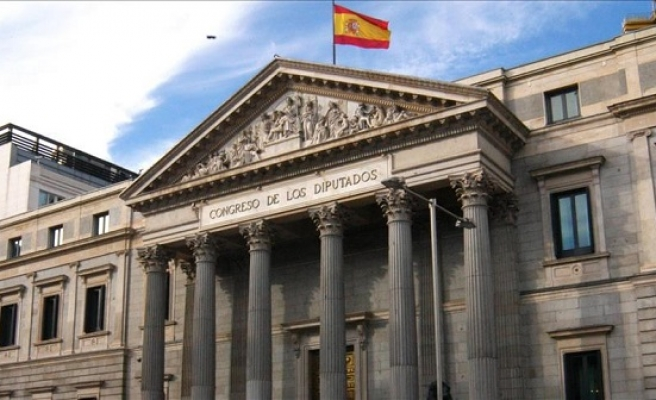 Spain rating raised to 'A-', outlook positive