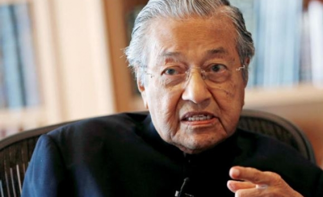 Malaysia's former premier declares election victory