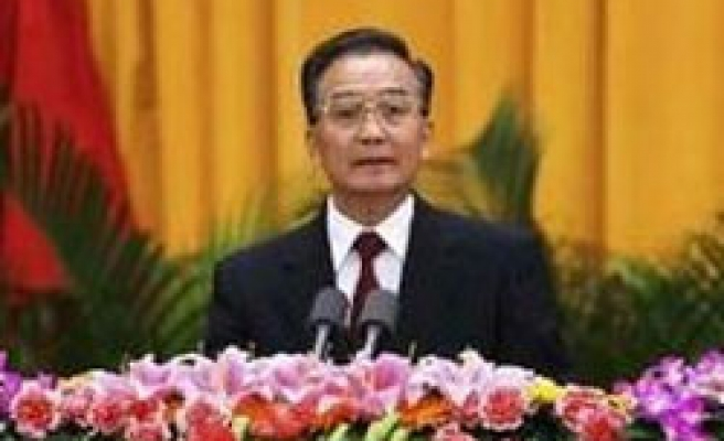 China's Wen vows to control inflation in new year