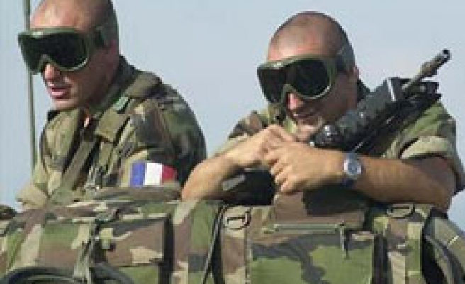 France says NATO troops kill four young Afghans