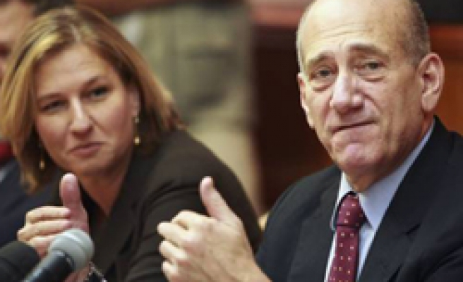 Olmert becomes Israel's first indicted PM over corruption