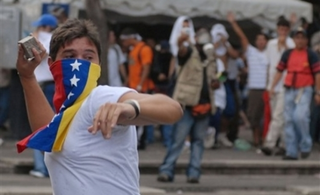 Venezuelans protest as TV station shuts