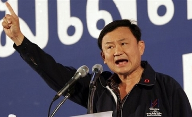 Ex-Thai PM urges stunned supporters to accept ban