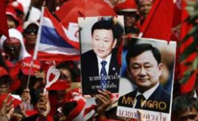 Thai army intervention law force Thaksin supporters to delay rally