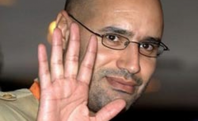 Son of Libya's Gaddafi denies family feud
