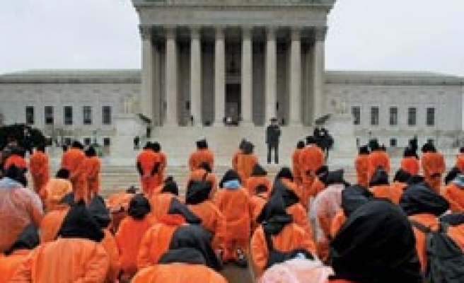 US review: indefinite detention, challenge for Guantanamo