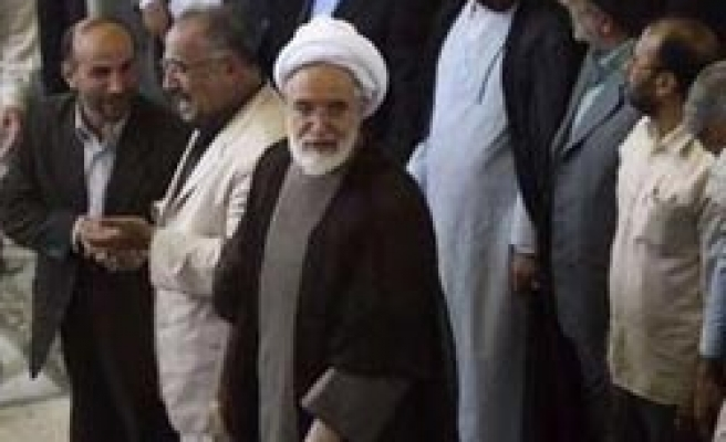 Iran arrests son of opposition leader-report
