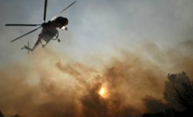 Wildfire rages in Greece for second day