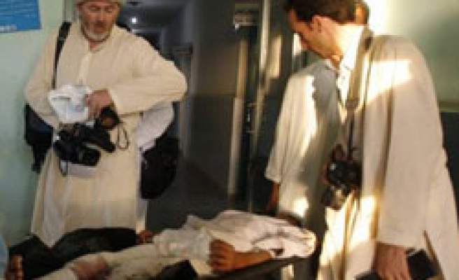 NATO kills Afghan woman, journalist to release NY Times reporter