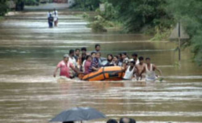 Death toll expected to rise as floods kill 200 in S. India / PHOTO