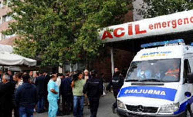 Turkish doctors remove bullets in union leader's foot