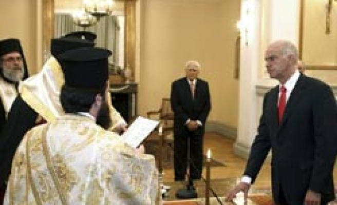 New Greek PM sworn in, cabinet to be appointed Tuesday
