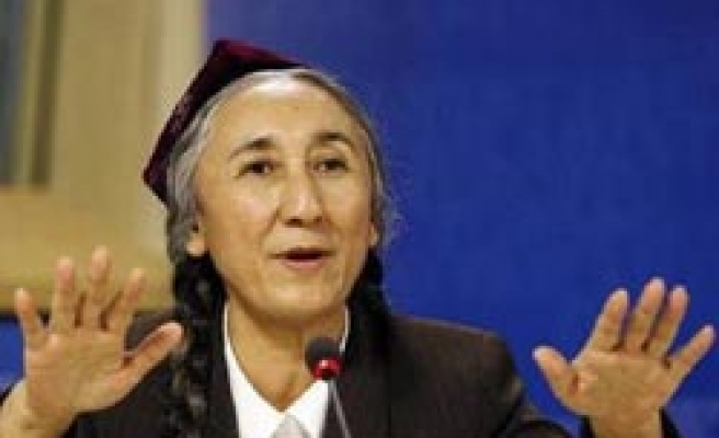Exiled Uighur leader urges calm after China attack