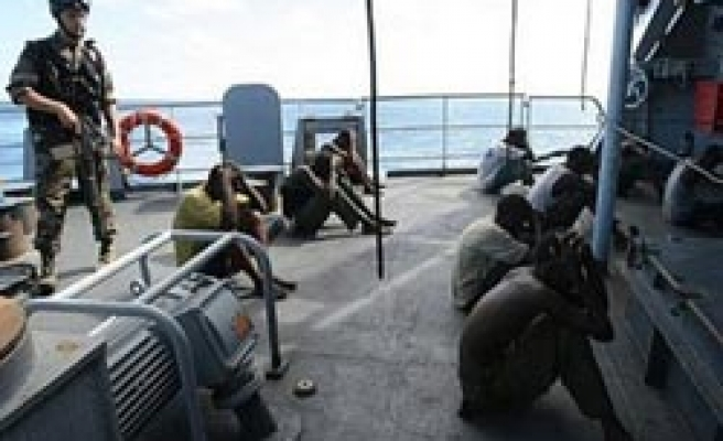 US charges 11 Somalis with piracy in ship attacks
