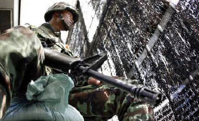Thai protesters call off march, to stay in base 'indefinitely'