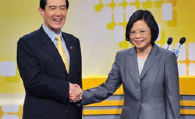 Taiwan president, opposition clash over China deal