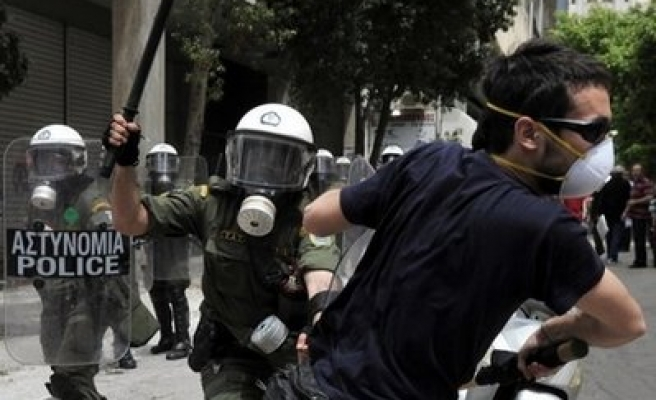 Greeks march against austerity, set new strike