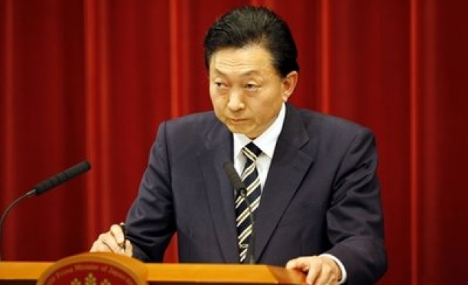 Japan's Social Democrats leave coalition government