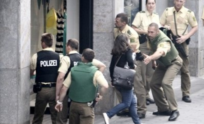 Gunman who takes hostages in store surrenders to German police