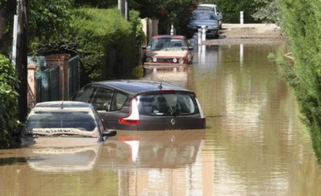 French storms and floods kill 18, about 10 missing