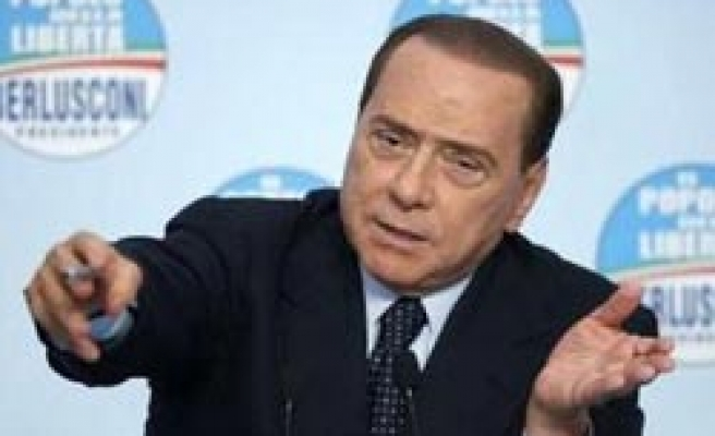 Italy court partially strikes down Berlusconi trial law