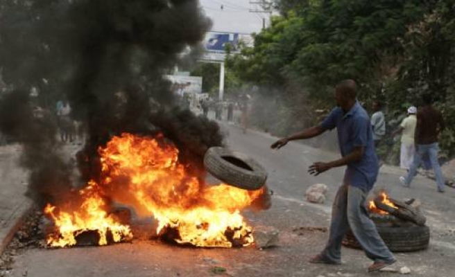 Haiti election protesters attack ruling party headquarters