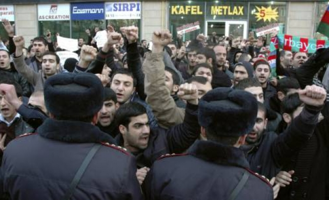 Protesters arrested, Azerbaijan insists new headscarf ban