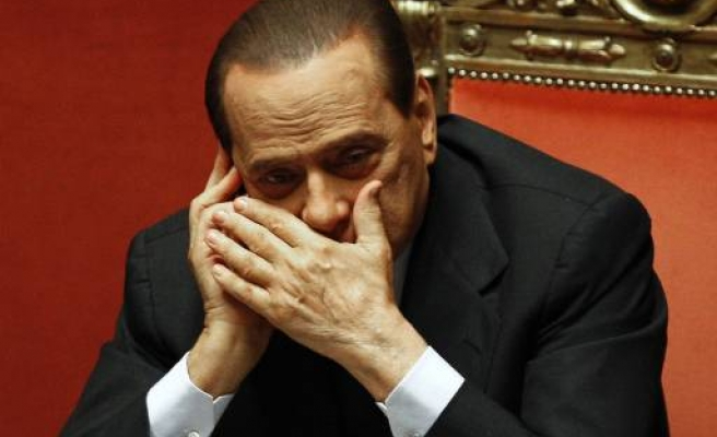 Berlusconi wins first round in no confidence vote