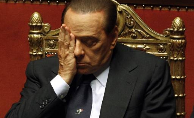 Berlusconi survives no-confidence vote, future uncertain