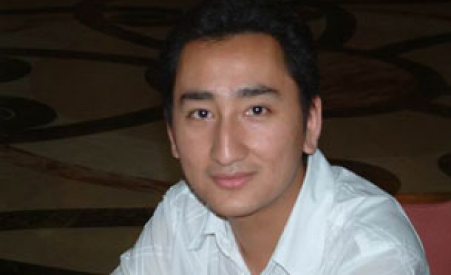 China sentences Uighur journalist to life for reporting protests