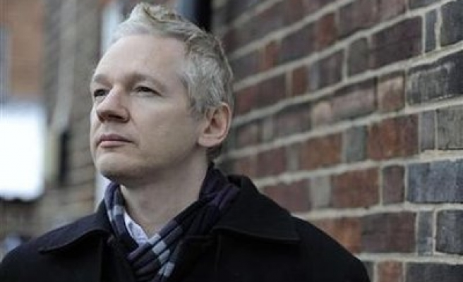 WikiLeaks founder says enjoys making banks squirm
