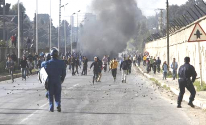 Algerian youths protest over food prices, unemployment