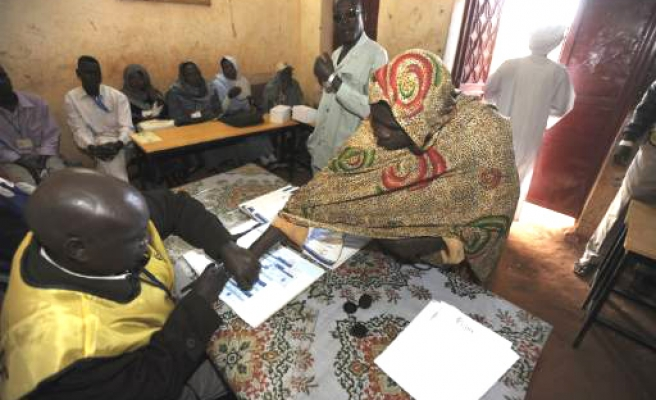 North to take on all Sudan debt, second day voting underway