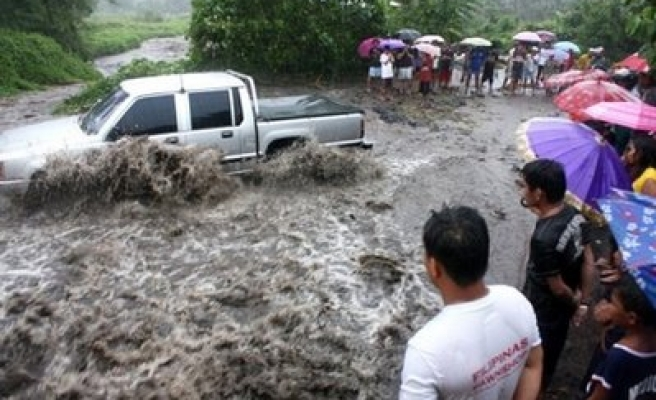 Many killed in Philippine floods, landslides