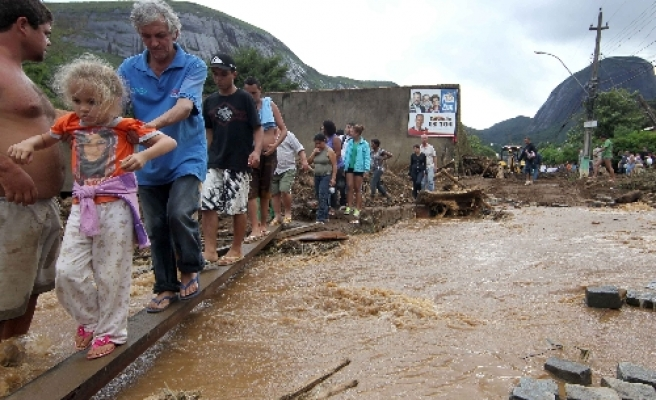 Brazil floods, mudslides leave hundreds dead - UPDATED