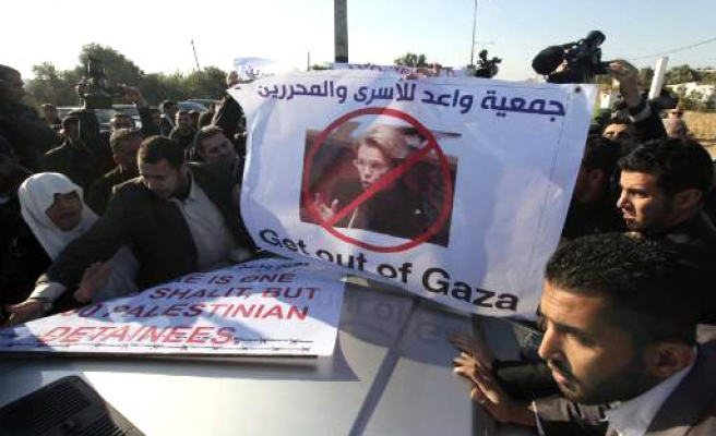 Families of Palestinians in Israel jails protest French FM