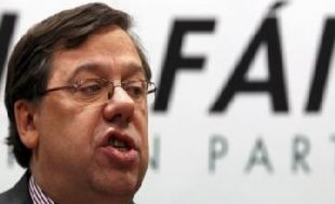 Cowen resigns as party leader, remains Irish PM