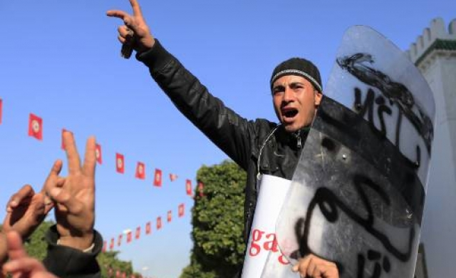 Tunisians protest after two men die in police cells